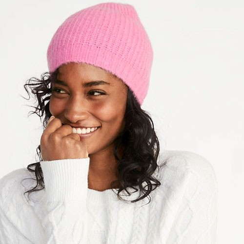 women smiling wearing a beanie hat